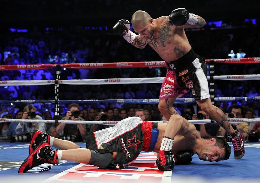 Sergio Martínez in the canvas after Miguel Cotto beats him (Top Rank)